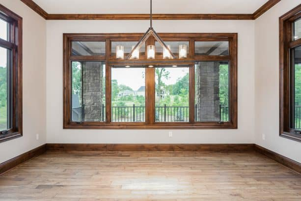 a craftsman interior with coordinating stained-wood baseboard, window casing, and crown molding