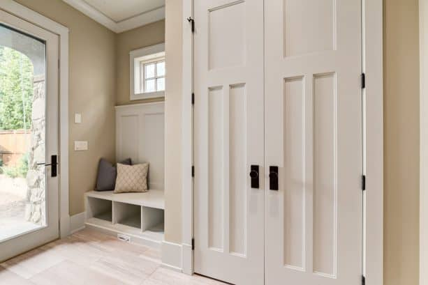 custom mudroom bench and crown molding in a craftsman entry