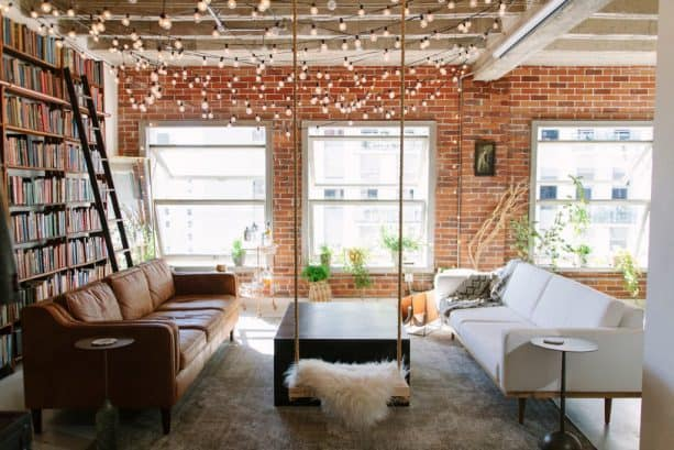 string bulbs to add charm to an industrial farmhouse living room