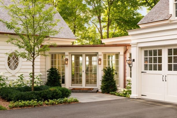 beach-style covered walkway looks stunning with antique white color and French doors