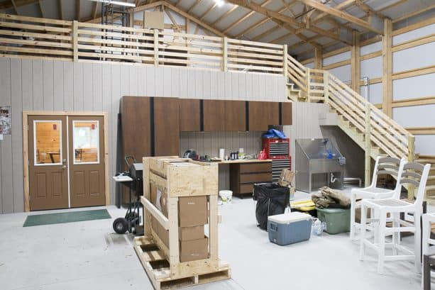 the loft inside the pole barn garage functioned as extra storage space