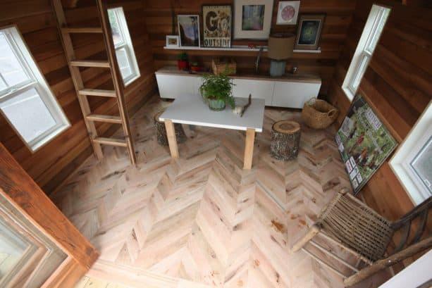 the living area with stylish herringbone floor