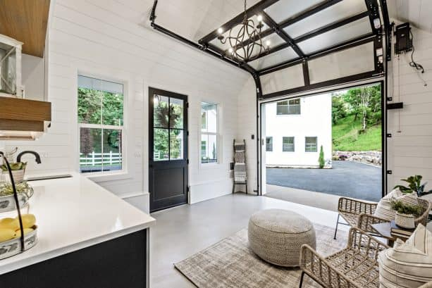 the space-friendly sectional garage door seen from the shed interior
