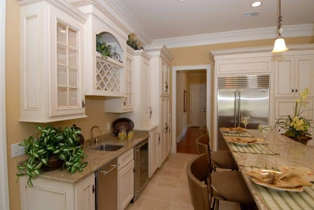 traditional kitchen with antique cabinets with white molding trim