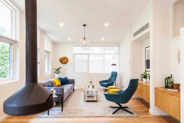 grey and teal living room with the mixture of modern and midcentury styles