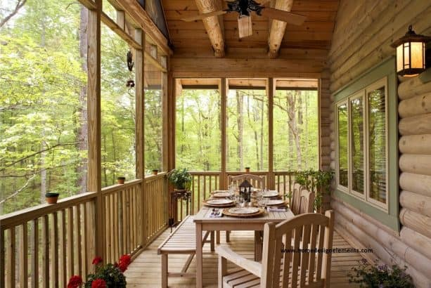 a log house porch with tongue and groove ceiling
