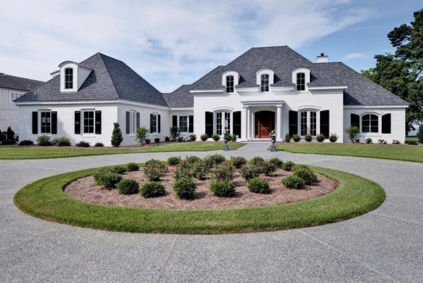 non-rectangular black shutters decorating a white house exterior