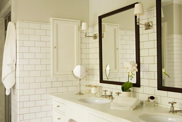 cozy traditional bathroom with warm white subway tile and platinum gray grout
