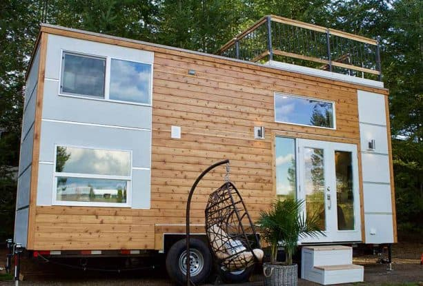 a multitone tiny house exterior with roof deck at the top
