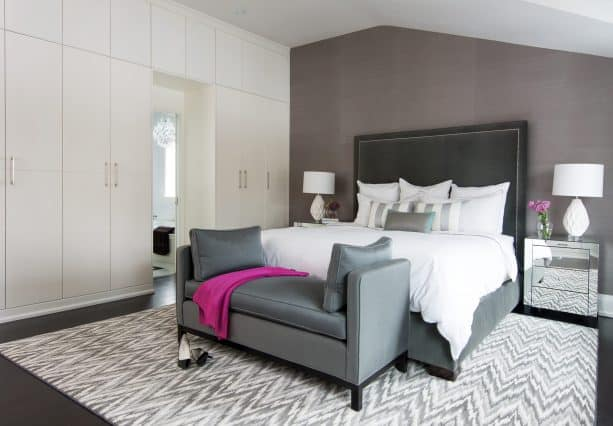grey and white bedroom with fuschia pink accent
