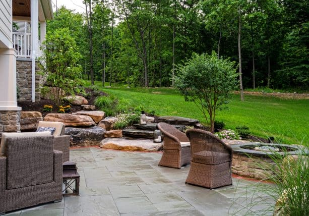 the stunning landscape design and views from the walkout basement patio
