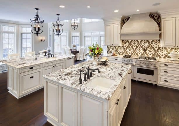 cream kitchen cabinets with white black-veined granite countertops