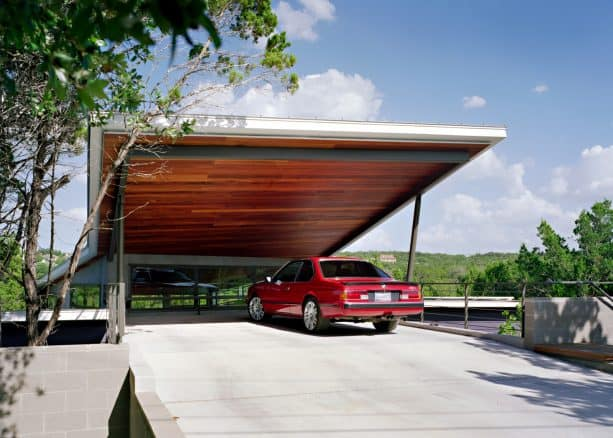 an attached contemporary carport looks really trendy with shed roof and visible wood ceiling