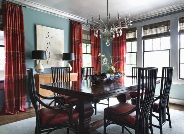 blue walls and red curtains in an eclectic dining room