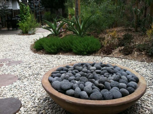 a neater look with round fire pit and round black lava rocks inside it