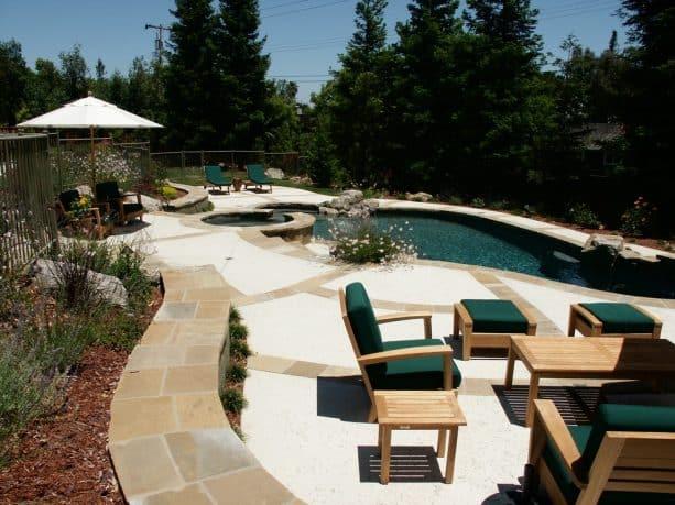 small custom inground pool with dark bottom