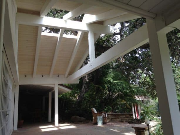 a solid patio cover with white tongue and groove roof deck