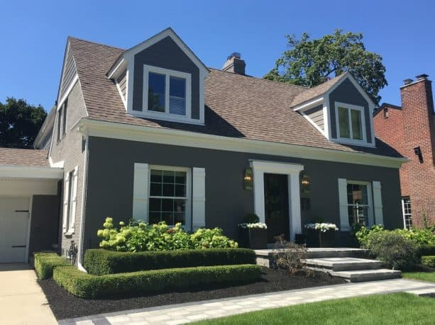 the house after getting a dark grey and white trim renovation