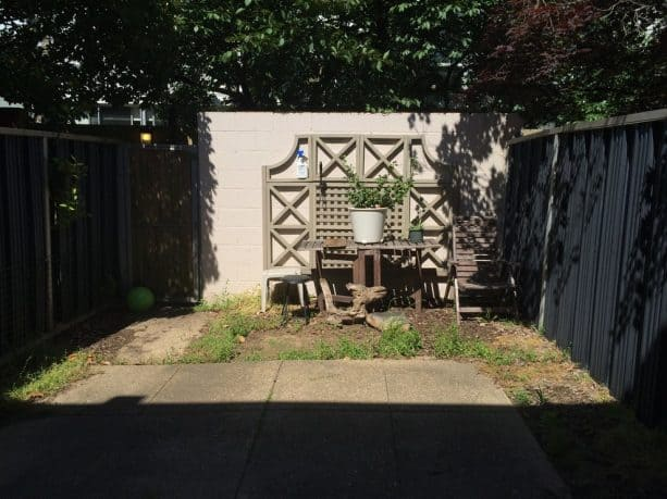 how the cinder block garden wall looked like before the makeover
