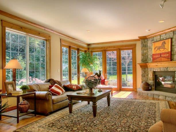 rustic family room with light stained wood trim and Kelly Moore #230 Graystone wall paint color combinations