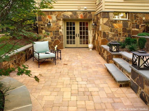 a sunken-style walkout basement patio with stairs