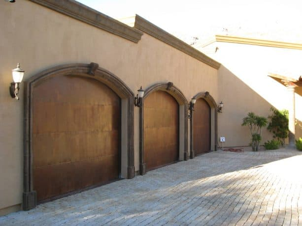 wood brown trim for a Tuscan brown stucco in Mediterranean-style exterior