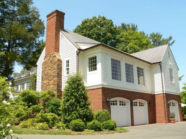 a classic, timeless exterior look created by using half white siding and half red brick materials