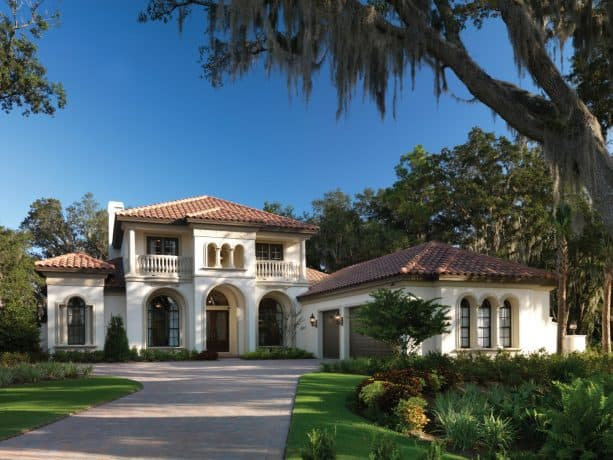 ivory white mountain home with clay roof shingles