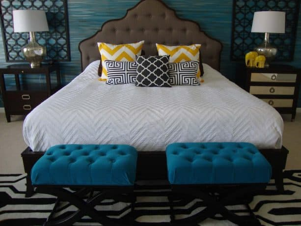 a pair of gorgeous tufted ottomans in a bedroom with teal and black contemporary-style