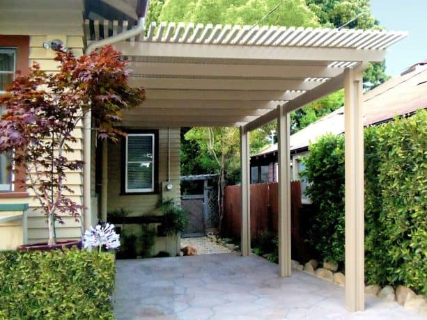 an aesthetic attached carport with pergola-style detail on each edge