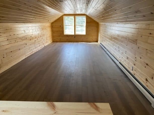 the loft interior looks so neat because of the wood siding