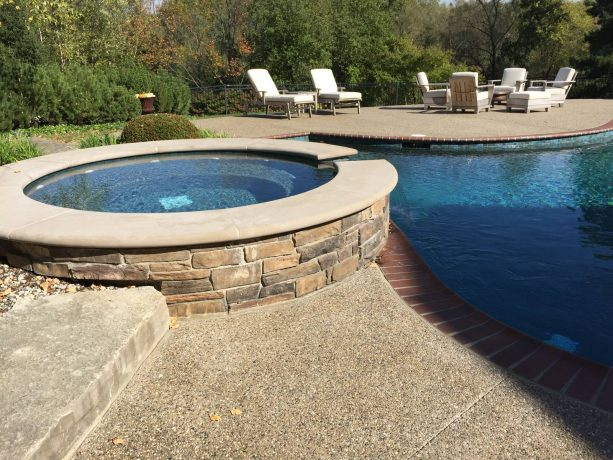 pool deck and patio with exposed aggregate concrete floor