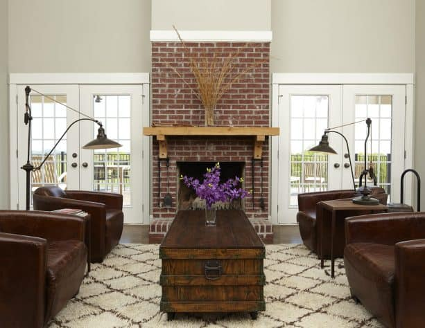 grey and brown living room with four leather chairs