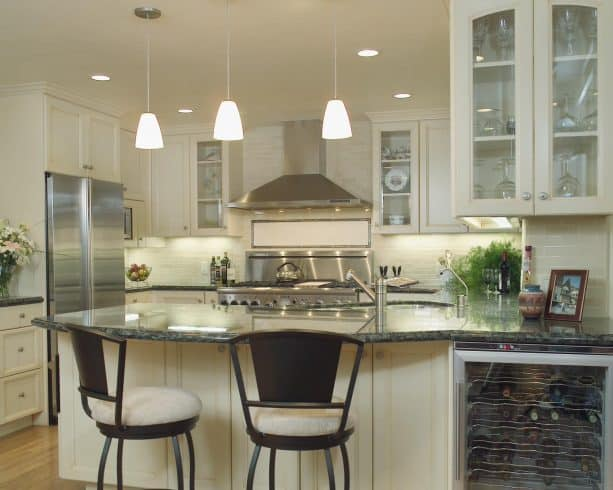 cream kitchen cabinets paired with stainless steel appliances