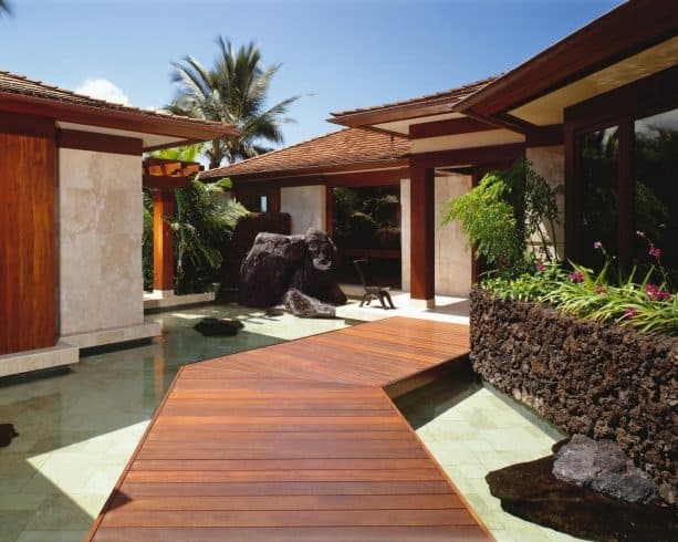 black lava rock wall with planter on the top