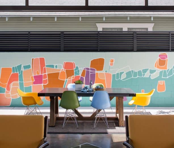 a cinder block wall with colorful mural for a more decorative patio