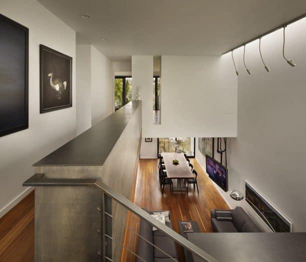 a half wall as a safety rail in a modern hall