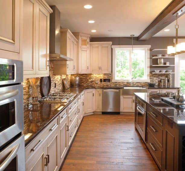 base, wall, and island cabinets with brown granite countertops in a traditional kitchen
