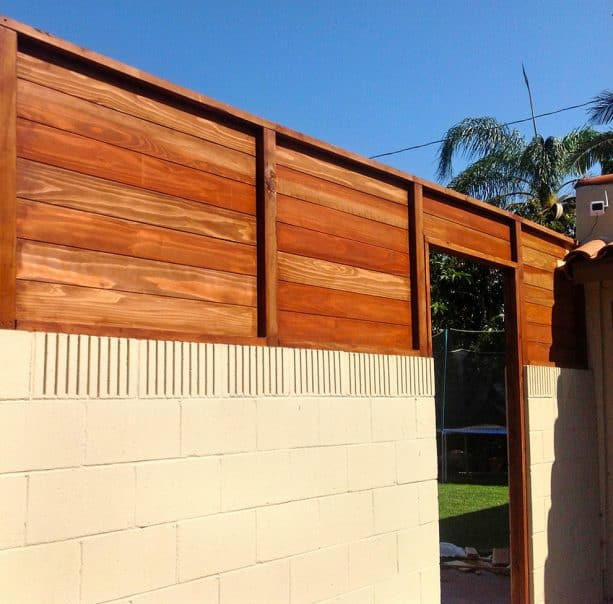 tall privacy fencing from cinder block and wood