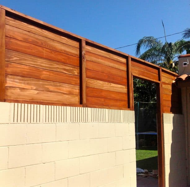 ivory cinder block walls with redwood fence combination
