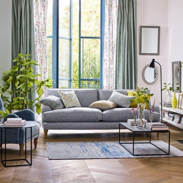 grey living room with herringbone wooden floor