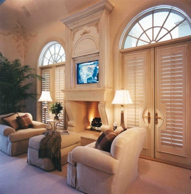 French doors covered with beige custom plantation shutters