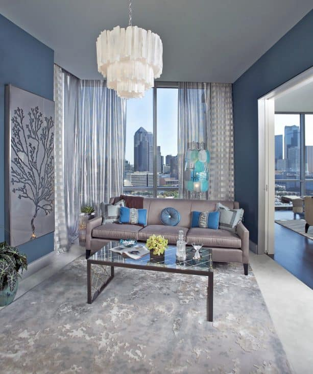 semi-sheer silver curtains in a blue and grey interior