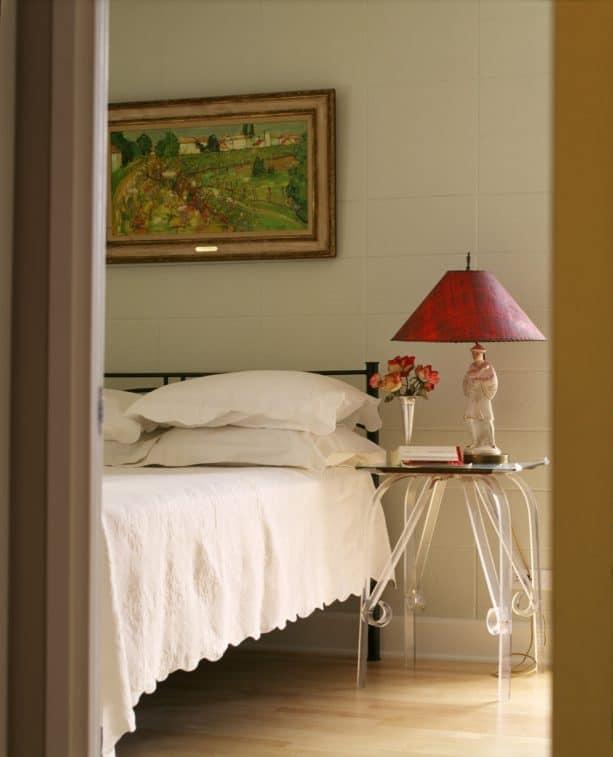 an eclectic bedroom with beige cinder block walls