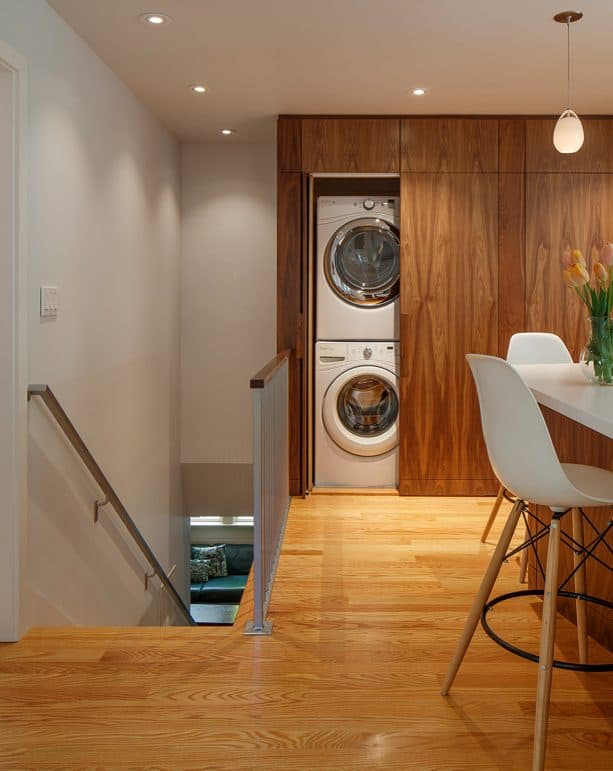 large flat-panel cabinet doors for laundry closet in a midcentury kitchen