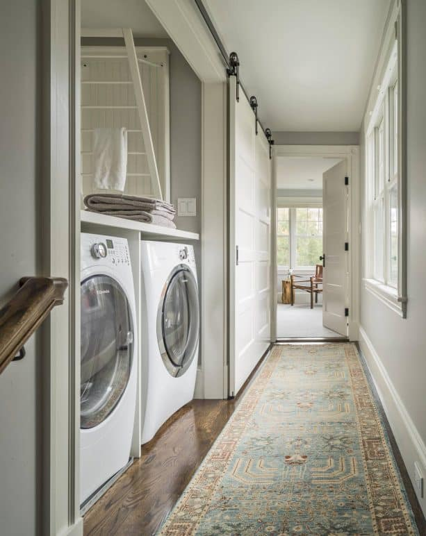 a large sliding door for a laundry closet built in a narrow place