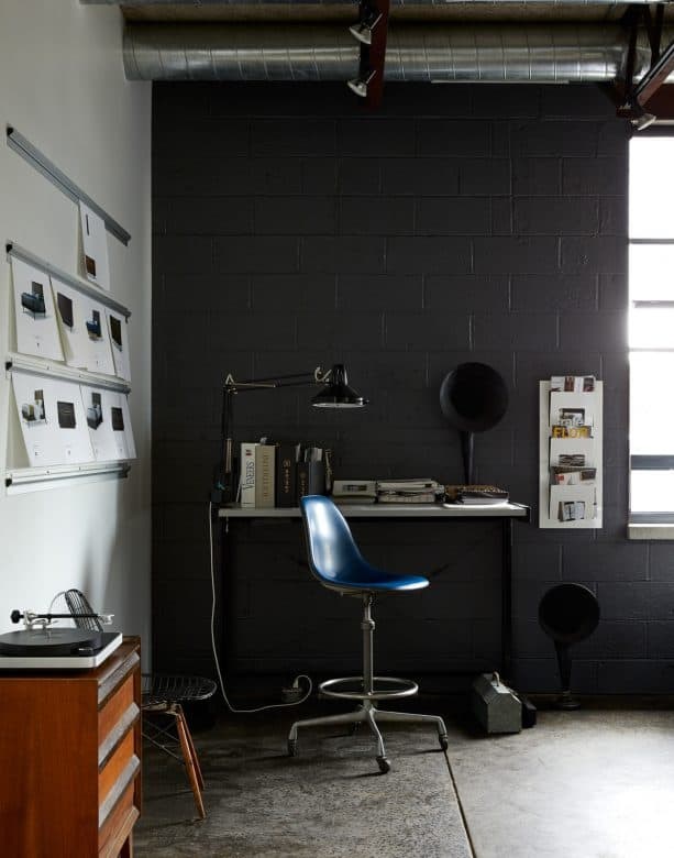 an industrial office nook with black cinder block wall