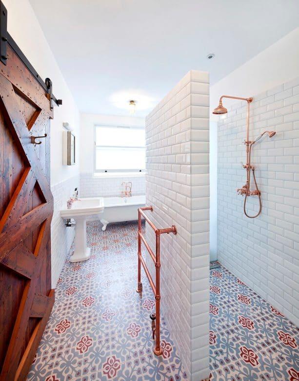 a contemporary bathroom with bulky barn door