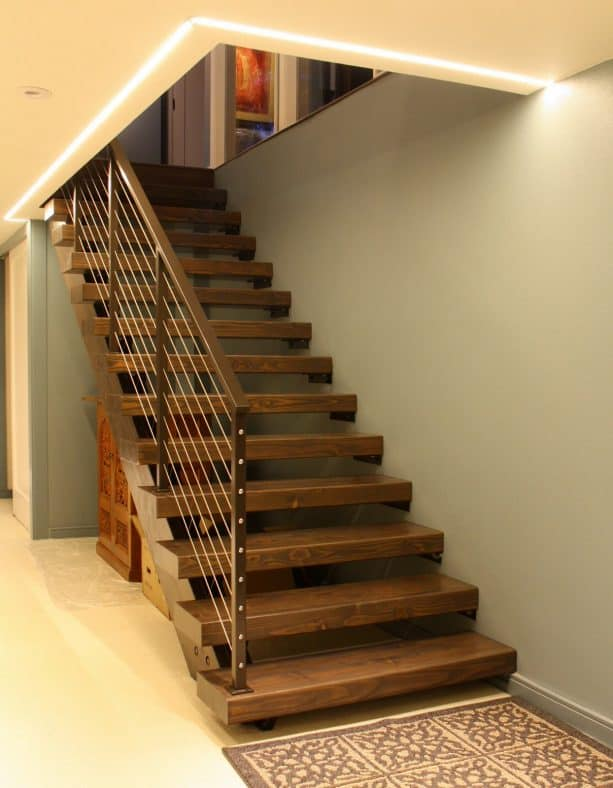 wooden open staircase with coordinating color with the metal railing