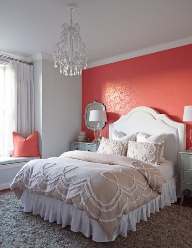 gray bedroom with blush red accent wall